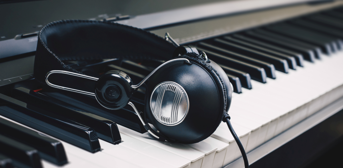 headphones on piano keys
